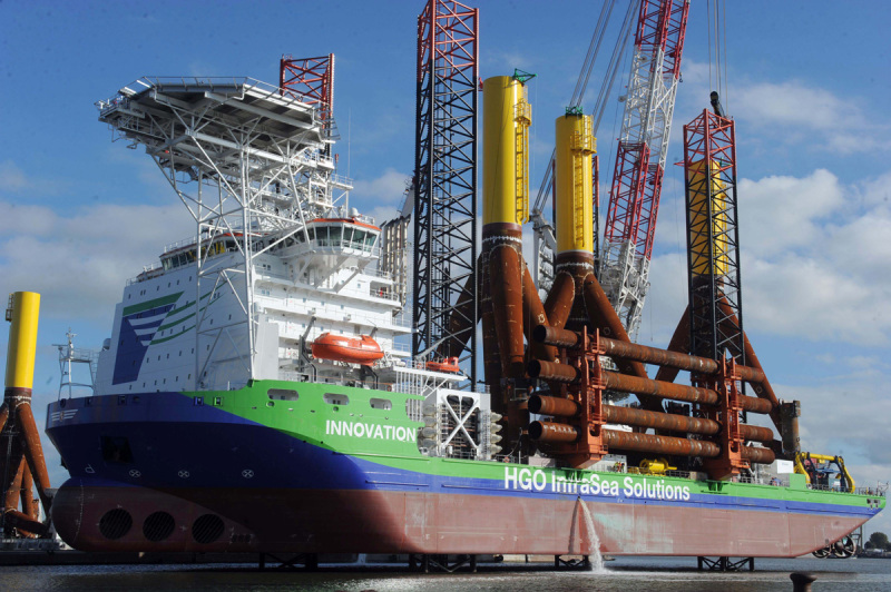 Offshore Logistics: Installation ship INNOVATION loading foundations for offshore wind farm Global Tech One.